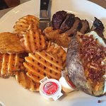 7 oz steak with loaded baked potato and waffle fries