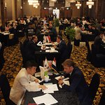 Business meetings in a large function room