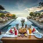 Breakfast by the pool at MiMPi Restaurant