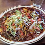 Carne adovada enchiladas with red chile.