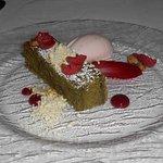 pistachio cake and raspberry ice cream dessert