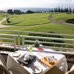 Enjoy a table over looking The Plantation Golf Course and stunning views of  Honokahua Bay.