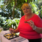 My mom Enjoying cheese tasting at Brown cheese factory