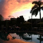 October sunset at the pool in front of hotel