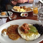 Loved my huevos rancheros, potato-carrot pancakes, and free little scone.