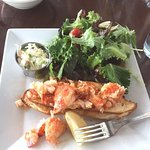 The hot buttered lobster roll with salad and slaw, perfection on a plate!