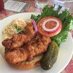 Crispy haddock sandwich on a brioche bun.