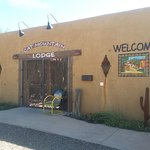 The facade of Cat Mountain lodge with artisan decorative touches that reflect the Southwest.