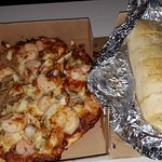 The Titanic seafood pizza and their garlic bread.