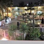 Lovely pool area and landscaping. View from Room #208 at night.