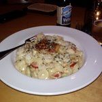 Orriechietto pasta with homemade pancetta in a creamy garlic sauce.