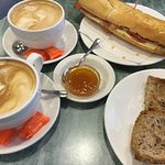 cafe con leche, bacon and cheese bocadillo, 7 grain toast with apricot jam