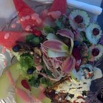 another salad with edible lily flower on top