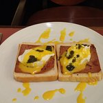 "Eggs benedict on white bread with ""ham"". The dark blotches are pesto which was actually quite ta"