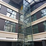 Glass elevator inside reception atrium area
