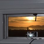 Time-lapse photography of sunset from room window