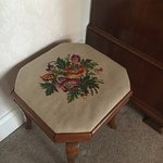 Needlepoint stool - one of the many antiques in the room