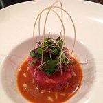 Toro tuna tartare, soft cooked egg in the middle, pine nuts and micro greens, spicy bimbibop sau
