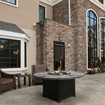 Our outdoor patio features a gas firepit