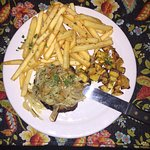 Beef filet with onions, acorn squash, french fries - good!
