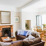 Kingsmoor Cottage living dining area with open fireplace, Mylor