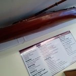 Gorgeous wood kayak just above our table and the wall menu