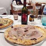 Pizza con radicchio, porchetta,, their wine bottle!