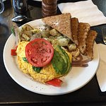 Best veggie omelette with home fries, with fresh multigrain toast. What a great breakfast with d