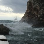 cove near hotel. Stormy sky with crashing waves