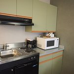 Kitchenette with bar fridge, coffee maker, mini microwave, and a sink