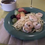 Shrimp Scampi, linguini, and fruit salad, Ala care. Hot tea.