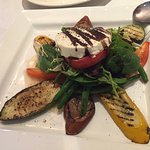 Warm goat cheese and grilled vegetables appetizer