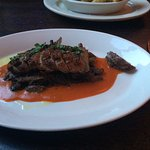 Duck breast in a slightly tangy buffalo sauce - so good!