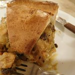 Huge slice of chicken and mushroom pie with a tasty bread-like crust.