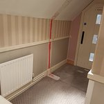 carpet and wallpaper missing in the 'executive rooms' building