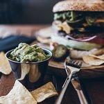 Nacho burger with crunchy topitos and guacamole!