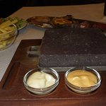 Hot stone for cooking, 2 sauces and butter for dipping.