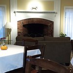 Seasoned fireplace in the dining room.