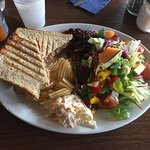 Delicious made to order tuna mayo & red onion toastie. Came with tasty, plentiful side salad, cr