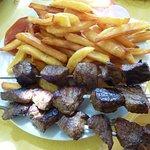 beef skewers and fries