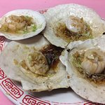 Steamed scallop on half shell with scallion and ginger