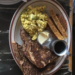 Sampler platter with french toast, tofu scramble, bacon and sausage