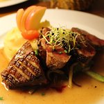 Pan fried duck breast with apple and cider, stir-fried vegetables, crushed potatoes