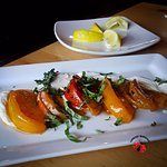 Caprese salad with a twist: tomatoes, peaches, and mascarpone