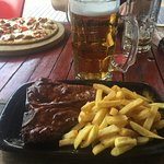 T-Bone Steak and Fries with a Liter of the Local Beer