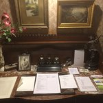 The writing desk, complete with ink set and family photos.