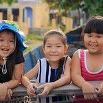 Little kids at Nam O beach, Danang city, Vietnam
