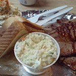Sliced brisket with potato salad, coleslaw, and Texas toast