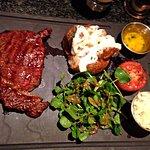 Ribeye Steak, served with baked potato, roasted tomato half, roasted mushroom, light salad
