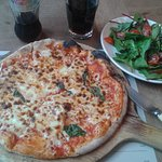 Pizza, salad and cold drink